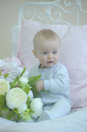 cute baby and white peonies Stock Photo - 19338020