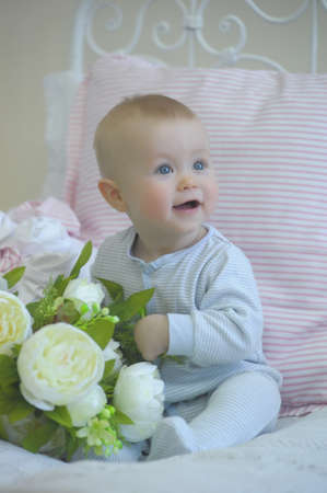 cute baby and white peonies photo