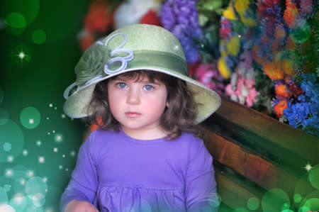 little girl in a hat on the bench Stock Photo - 19342130