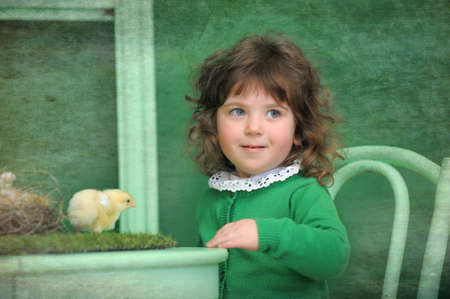 Girl with chicken photo
