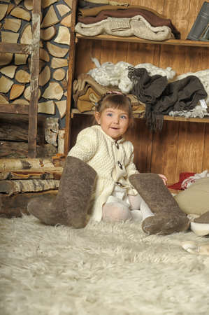 the little girl next to the wardrobe with warm clothes Stock Photo - 19338778