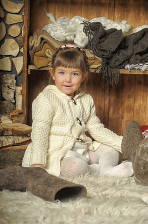 the little girl next to the wardrobe with warm clothes Stock Photo - 19327833