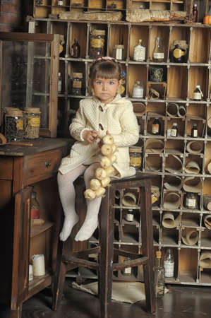 little girl on the old kitchen photo