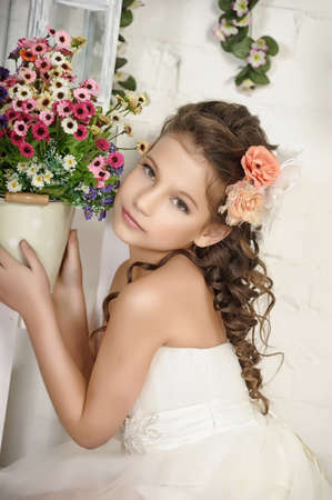 girl and a pot of flowers Stock Photo - 19340434