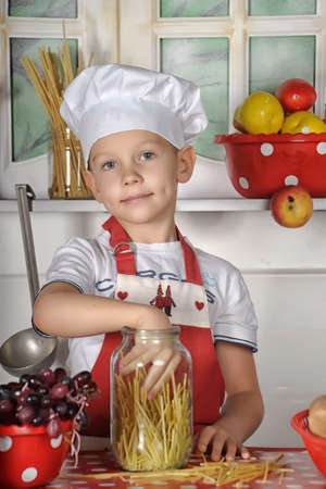 boy in a chef s hat in the kitchen photo