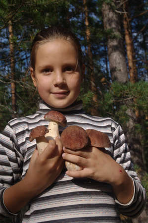girl holding a white mushrooms photo