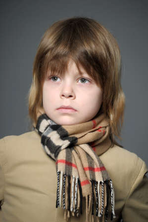boy wearing a cape and scarf photo
