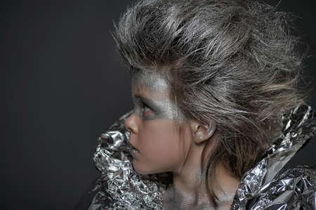 avant garde: boy in a silver suit