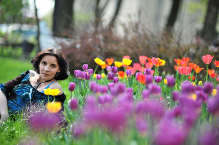 young woman among the tulips photo