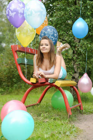 teenage girl on a bench in the park with balloons Stock Photo - 19559054