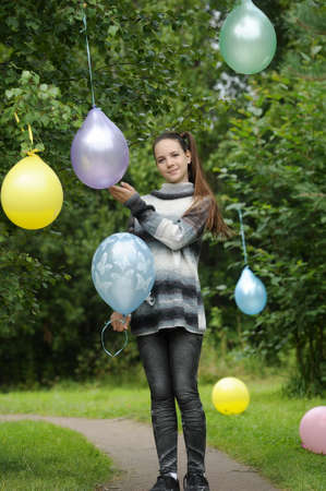 Young girl with colorful latex balloons Stock Photo - 28394509