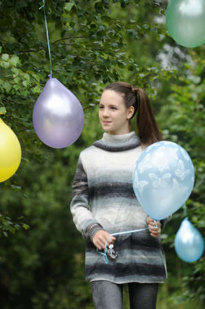 Young girl with colorful latex balloons Stock Photo - 28394612