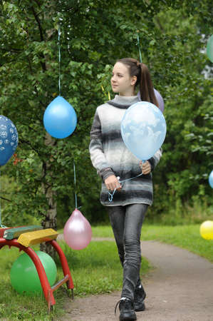 Young girl with colorful latex balloons Stock Photo - 28417833