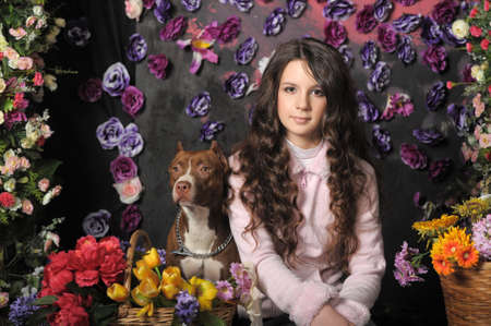 Beautiful girl with dog on a floral background Stock Photo - 20430128
