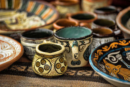 Handmade clay pots In a workshop photo