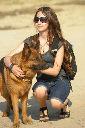 Young German shepherd dog with the teen girl  photo