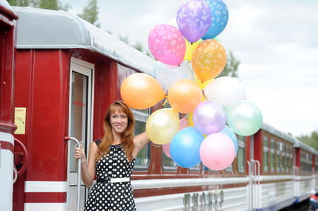 Girl with balloons and train photo