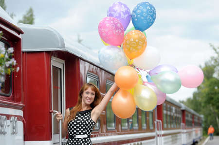 Girl with balloons and train Stock Photo - 21015791