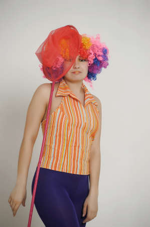 Girl with balloons in a colored wig photo