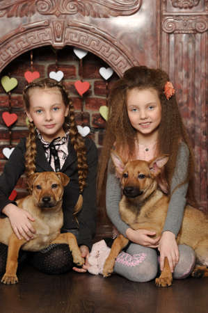 Two sister girls with puppies photo