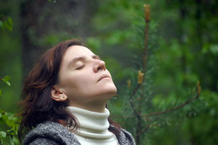 Portrait of a woman resting in the forest  photo