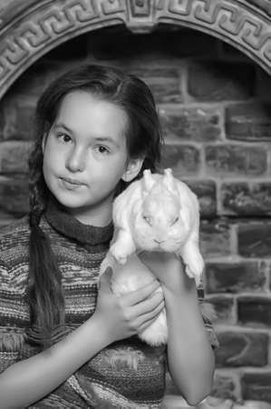 girl with white rabbit photo