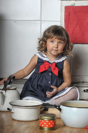 Little girl in the kitchen photo