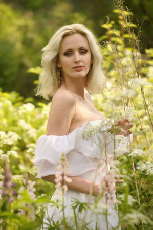 Charming girl on the nature photo