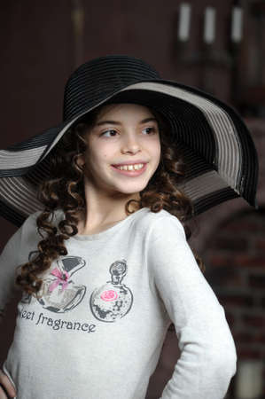 teen girl in curly hair in a wide-brimmed hat Stock Photo - 21997265