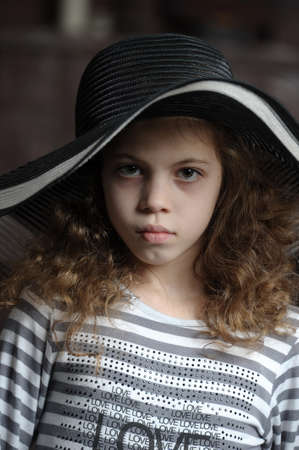 teen girl in curly hair in a wide-brimmed hat Stock Photo - 21997293