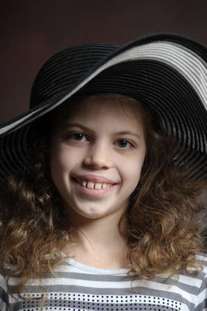 teen girl in curly hair in a wide-brimmed hat Stock Photo - 21997294