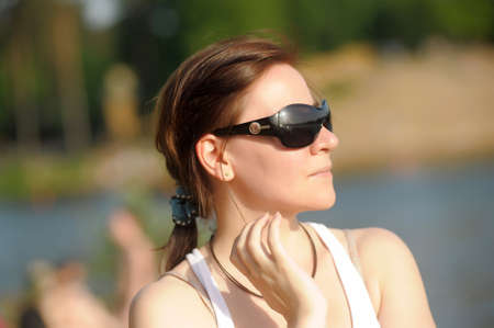 Girl in sunglasses photo