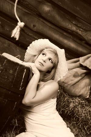 Photo of beautiful girl posing on the farm photo
