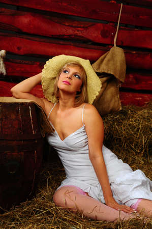 Photo of beautiful girl posing on the farm photo