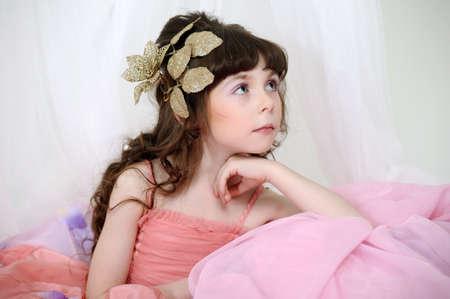 pert: Little, cute girl wearing pink dress.