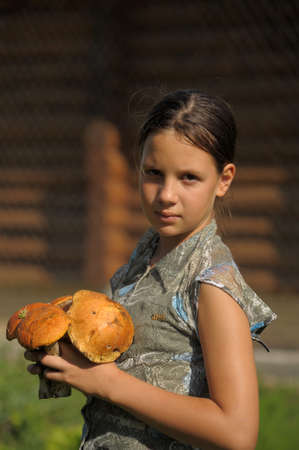 fungous: Girl with mushrooms in hands