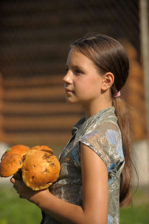 boastful: Girl with mushrooms in hands