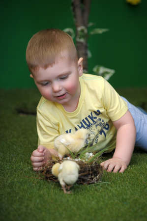 cary: Happy boy on floor with pet chick