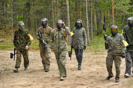 a group of players in a paintball