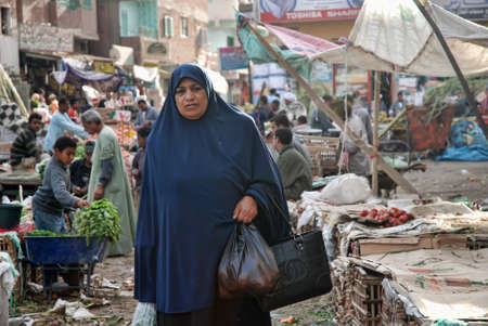 burqa: woman in a burqa on the streets of Egypt