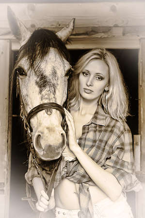 Sexy slim blonde with a horse Stock Photo - 21690760