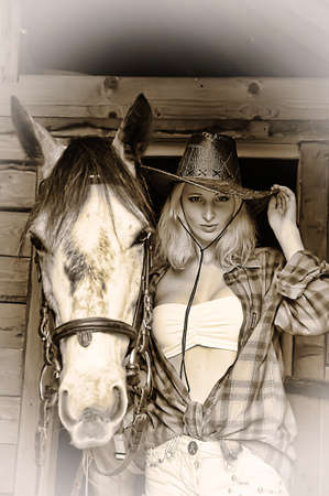 Sexy slim blonde with a horse Stock Photo - 21690762