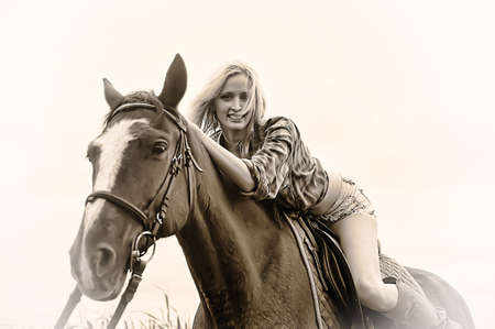 sexy blonde with a horse photo