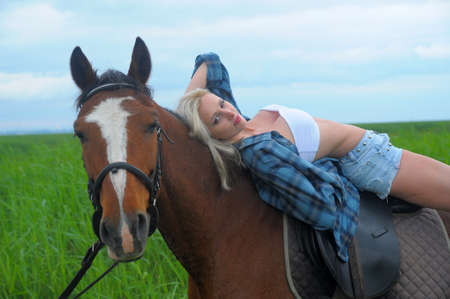 sexy blonde with a horse Stock Photo - 21732531