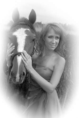 young beautiful woman with a horse, retro photo photo