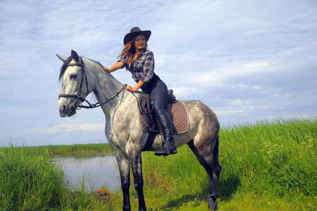 black cowgirl: girl in a cowboy hat on a horse