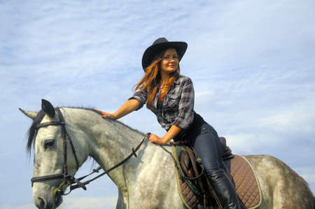 nevada desert: girl in a cowboy hat on a horse