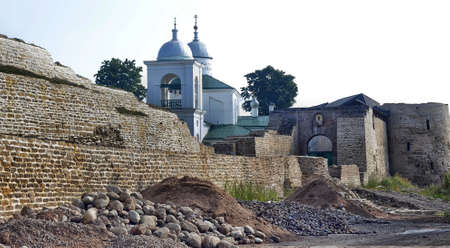 The old fortress and the church in the ancient Russian city of Izborsk photo