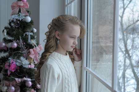 girl at the window Christmas