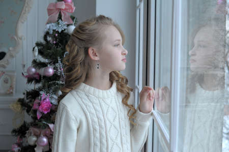 girl at the window Christmas photo